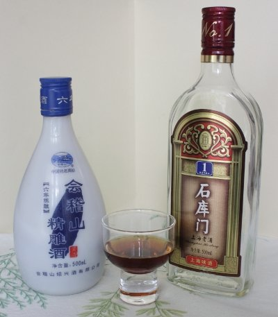 Two Shaoxing Wine Bottles and a Glass of Shaoxing